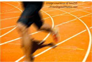 Legs of a person running on a track