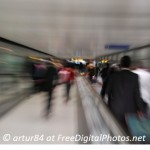 A blurred picture showing people rushing in an underground station