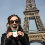 Katharine Fennelly with her Paris Marathon medal in front of the Eiffel Tower