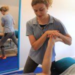 Lizzie Hewitt giving a massage