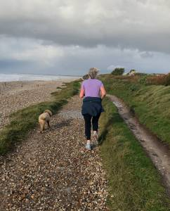 Natasha Price, MD of Central Health Physiotherapy, running on the beach during ACL rehabilitation