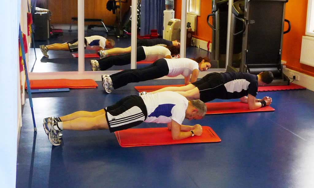 People doing planks in the HIIT class