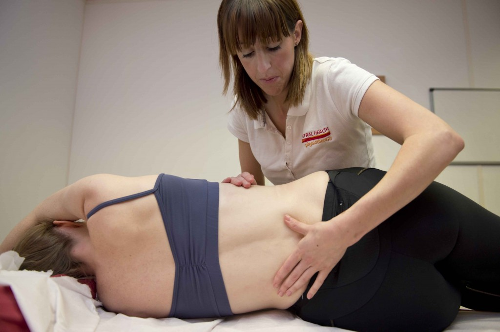 Physiotherapist treating a patient