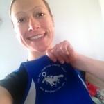 Vicky Frosdick holding her Bob Champion vest