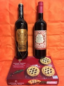 A picture of two wine bottles and two mince pies