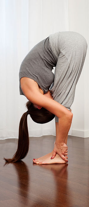 Woman with hyper mobility syndrome stretching