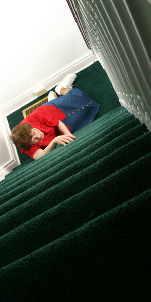 Lady fallen on stairs