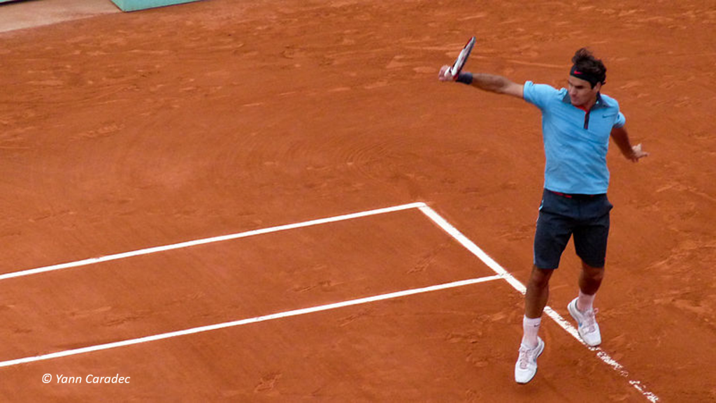Picture showing someone playing on clay at The French Open Tennis
